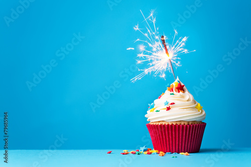 Cupcake with sparkler on blue - 79685964