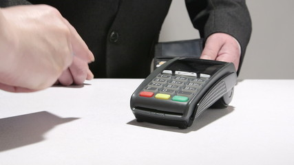 Business person paying using credit card