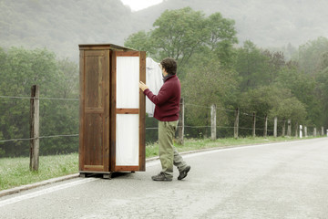 wooden wardrobe with a man