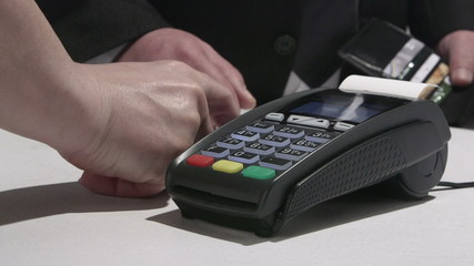 Person using credit card processing terminal in Ukraine