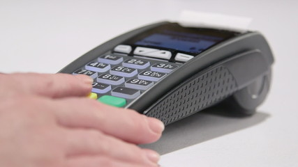 Swiping card through credit card terminal and printing receipt