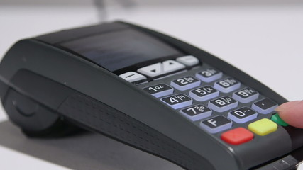 Dolly: Person using credit card payment terminal