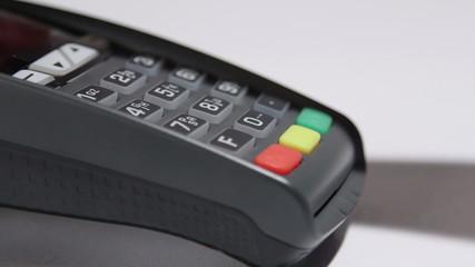 swiping debit card through credit card reader and entering PIN