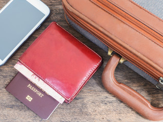 Mobile phone, passport and briefcase