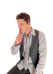 Man with finger over mouth.