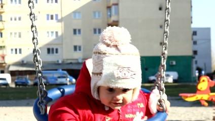 Baby in Swing Portrait