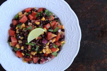 Black bean salad in white plate