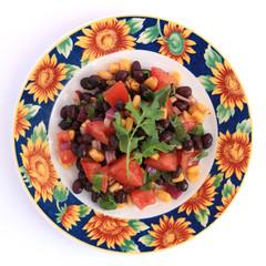 Black bean salad in sunflower plate