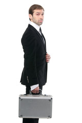 Confident stylish security guard whith a metal suitcase. Isolate