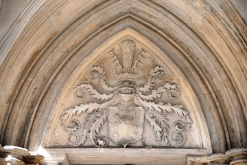 Gothic arch with coat of arms