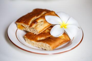 Cake decorated with flowers frangipani