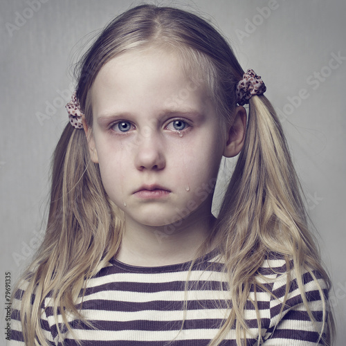 Little girl crying with tears - 79691335