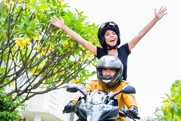 Indonesian woman feeling free on motorcycle