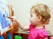 Little baby artist is painting