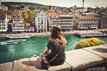 Female student looking at Zurich cityscape, Switzerland