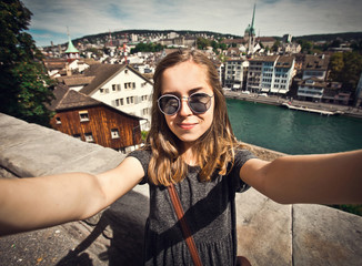 Female student makes selfie at Zurich cityscape, Switzerland