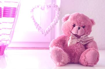 Romantic still life with pink plushy teddy bear