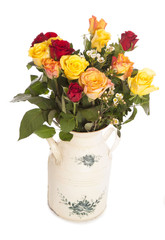 roses in a shabby chic vase