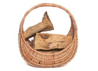 fire wood in a wicker basket