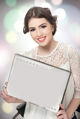 Hairstyle and make up - young girl holding a white paper, studio
