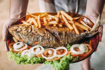 Fried horse-eye jack served in Pernambuco, Brazil.