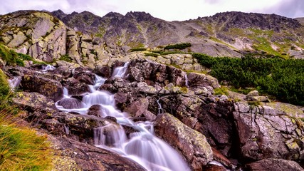 4k time lapse stream in the mountains