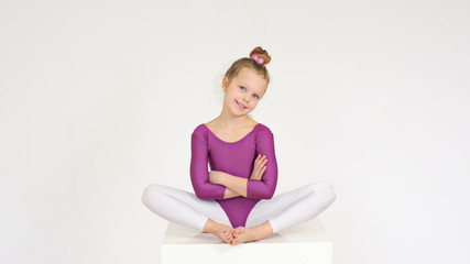 Flexible acrobatic girl with hands crossed