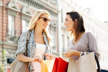 Two women enjoy shopping