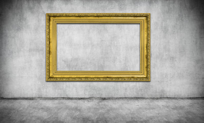 old golden frame on gray wall