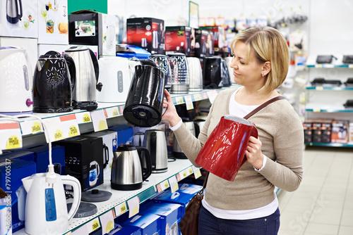 Leinwandbild Motiv Woman housewife shopping for electric kettle