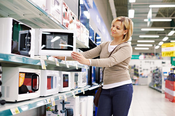 Woman housewife shopping for microwave oven