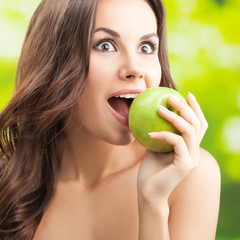 Woman eating apple, outdoor