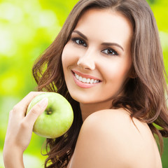 Woman with green apple, outdoor