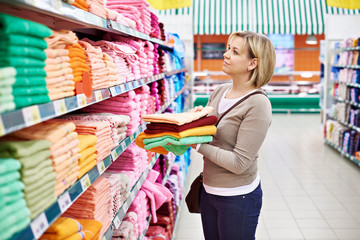 Woman buys towels in supermarket