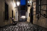 Old narrow street in Prague at night