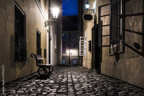 Foto op Canvas Praag Old narrow street in Prague at night