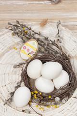Easter eggs. Easter eggs in nest on table
