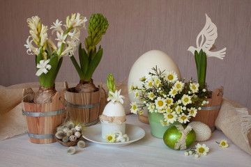 Spring flowers eggs on the table Easter