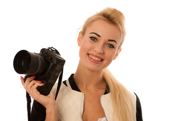 Woman holding a camera taking photos isolated over white backgro