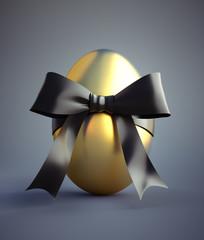 Goldenes Osterei mit schwarzer Schleife