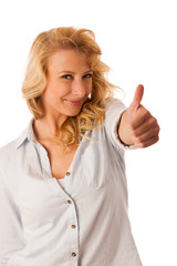 woman gesturing success with her hand showing ok sign thumb up i