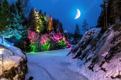 Leinwandbild Motiv Evening lights in the marble quarry Ruskeala in Karelia in the w