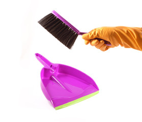 Hand with brush and dustpan