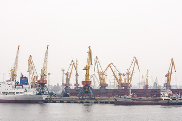 The loading of a cargo ship at dock in Odessa seaport