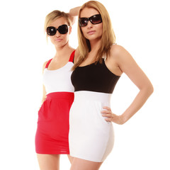 two sexy crazy women in summer clothes sunglasses.