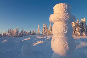 Giant snowman in winter wonderland