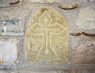 Ancient Greek Cross on the Stone Wall