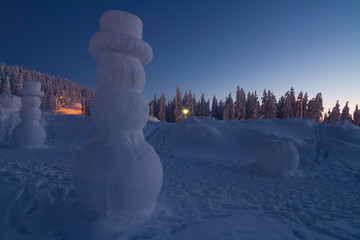 Giant snowman in winter wonderland