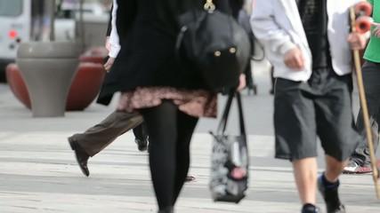 Crowds of pedestrians on a city sidewalk