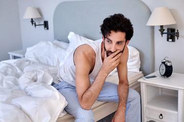 man sitting bed